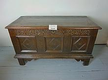 A good 18c oak coffer with three carved panels to front over a moulded skirt and feet est: £350-£450