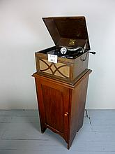 An early 20c 'His Master's Voice' gramophone player on mahogany cupboard stand and in working order est: £80-£120