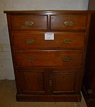 An Edwardian walnut chest of two short over two long drawers and cupboards beneath est: £100-£150