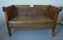 A fine 19c possibly Spanish oak settle with carved horses, panelled back and detailed carving est: £200-£400
