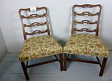 A good pair of George II mahogany chairs with pierced fret work back rails est: £200-£300