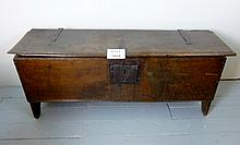 A 17c oak six plank coffer with iron strap hinges and lock plate est: £250-£450