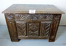 A 17c oak carved coffer of desirable proportions (later top) est: £300-£400