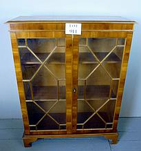 A 20c yew wood bookcase with astral glazed doors est: £50-£80