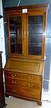 A Maple & Co mahogany bureau bookcase in clean condition est: £90-£120