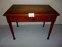 A pretty burr oak writing table with tan tooled leather top est: £380-£420