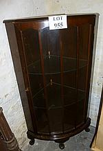 A 1930's mahogany corner cupboard on cabriole legs est: £15-£30