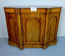 A Victorian serpentine fronted chiffonier with an arched panelled door flanked either side by cupboards est: £135-£165