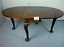 A 19c mahogany drop leaf dining table with carved chunky cabriole legs, pad feet and casters est: £50-£80