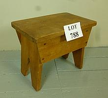 A 19c pine small stool with a lift up lid est: £20-£30