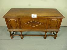 An early 20c camphor wood coffer with lift up lid over panelled front and turned legs est: £80-£120