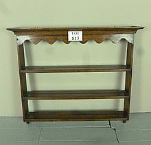 A 17/18c set of oak wall shelves with moulded pediment and carved frieze above three plat-rack shelves est £50-£100