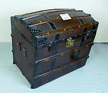 A 19c dome top leather trunk with metal and wooden straps est: £80-£120