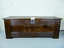 A 16th century oak long coffer with linen fold carved front panels beneath a later oak top and candle box inside of good rich colour est: £400-£600