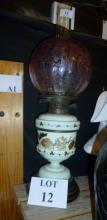 A painted glass oil lamp with etched cranberry glass shade est: £40-£60 (A1)