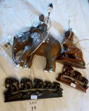 Two carved hardwood elephant 'families' and two lamp bases (a/f) est: £30-£50 (A4)