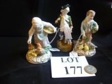 A pair of decorative Dresden figurines modelled feeding ducks or chickens; and another figure modelled as a huntsman est: £40-£60 (O4)