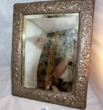 A silver embossed table mirror decoration with scrolls and flowers bevelled glass Birmingham 1902 est: £200-£300