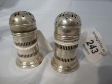 A pair of silver pepper pots hallmarked Birmingham 1945 est: £80-£120