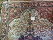 A large wool rug with central medallion (265 x 180 cm approx) est: £100-£150
