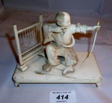 An oriental ivory carving of an kneeling archer signed (slightly a/f) est: £100-£130