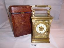A brass carriage clock engraved with birds and flowers J Edmonds with key and carrying case est: £200-£350