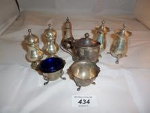 A collection of five silver pepper pots, two salts, and one mustard pot all fully hallmarked est: £70-£100