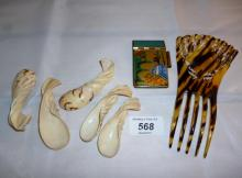 A set of five shell spoons, a hair comb and an oriental decorated notebook cover est: £20-£40