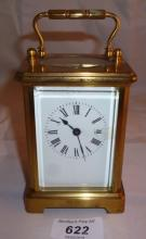 A brass carriage clock est: £60-£90