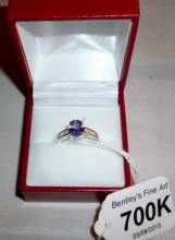 Bi colour tanzanite 1.50ct oval brilliant cut solitaire, 10K white gold, fully hallmarked, excellent condition (size N) boxed est: £200-£300