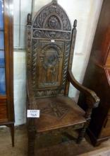 A Victorian oak Gothic high back throne chair with carved faces & monk to back c1850-70 est: £250-£350