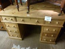 A pine pedestal writing desk with nine drawers est: £80-£120