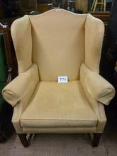 An early 20c winged armchair upholstered in pale suede good condition est: £170-£250