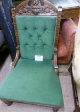A late Victorian oak lion mask green upholstered chair est: £80-£120