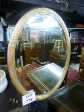 A late 19c gold reeded oval mirror est: £25-£45
