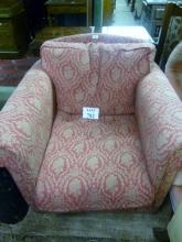A 20c fireside armchair in Burgundy and gold est: £65-£85