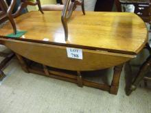 A reproduction oak low gate leg coffee table est: £50-£80