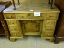 A late Victorian/Edwardian pine knee hole desk with inset centre cupboard flanked by four drawers est: £100-£200