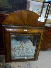 A fine 18c walnut cushion mirror with arched top and original glass est: £400-£600