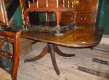 A 19c mahogany dining table with one leaf over a pedestal base (some alterations) est: £150-£250