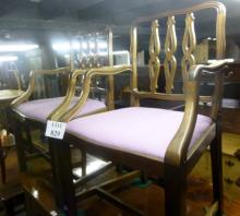 A pair of early 20c carver armchairs upholstered in purple est: £55-£75