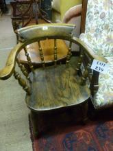 A late 19c elm seated Captain's desk chair est: £40-£60