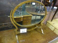An Edwardian mahogany oval table top swing mirror est: £40-£60