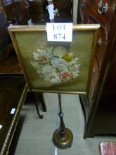 A 19c pole screen with detailed twist column and a needlework panel est: £40-£60