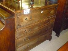 A George III mahogany secretaire chest of drawers with a fitted writing drawer over three long drawers est: £180-£220