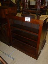 A late Victorian walnut open bookcase with three adjustable shelves est: £150-£250