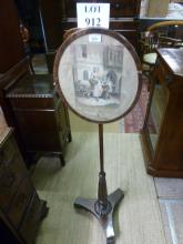 A 19c rosewood pole screen with oval screen 'Two Bunches a Penny Primroses' est: £40-£60