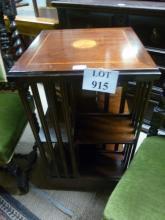 An Edwardian mahogany inlaid revolving book case est: £100-£150