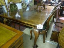A large two leaf extending mahogany dining table with cabriole legs, ball & claw feet c1900 est: £300-£500