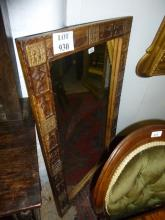 An ornate carved wall mirror depicting people and animals est: £50-£80